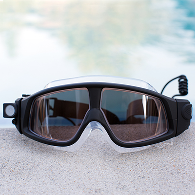 COLEMAN<sup>®</sup> VisionHD Swimming Eyewear - Capture hands-free 1080p video recording and 5MP stills with this swimming eyewear.  In addition to being waterproof up to 33ft, this eyewear is also freeze-proof and dust-proof with double coated anti-fog, anti-scratch, anti-shock UV protections lenses.  Includes built-in lithium-ion battery, USB cable and AC adaptor.  1080 full HD 30fps and 720p HD 60fps.  135° super wide angle lens.